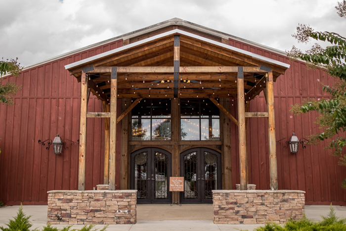 The Vineyard Hall's exterior features magnificent pillars, accented with iron doors, gas lanterns, and bistro lighting.